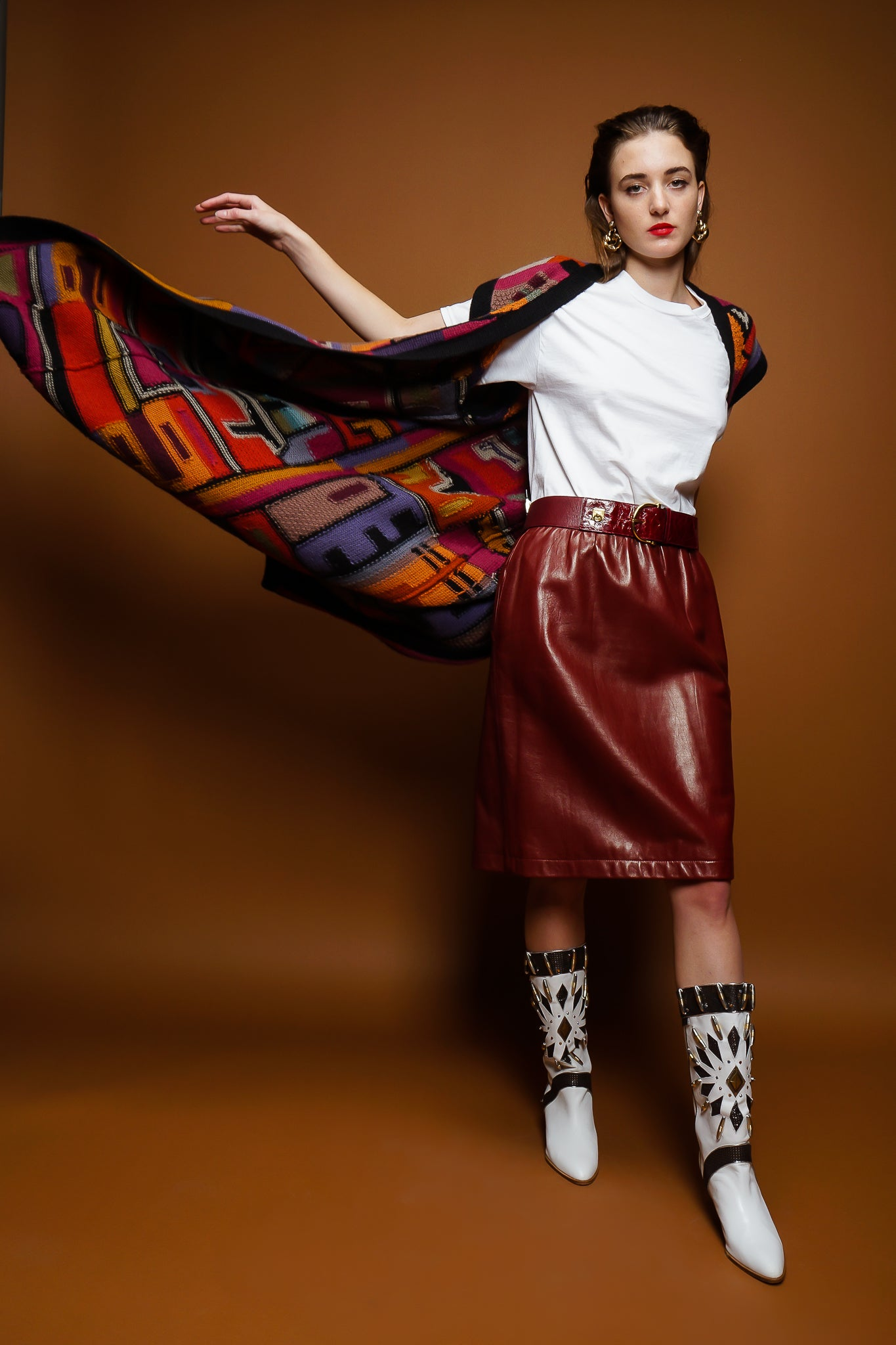 girl in Long Peruvian Connection duster vest & YSL leather skirt on brown @ Recess Los Angeles