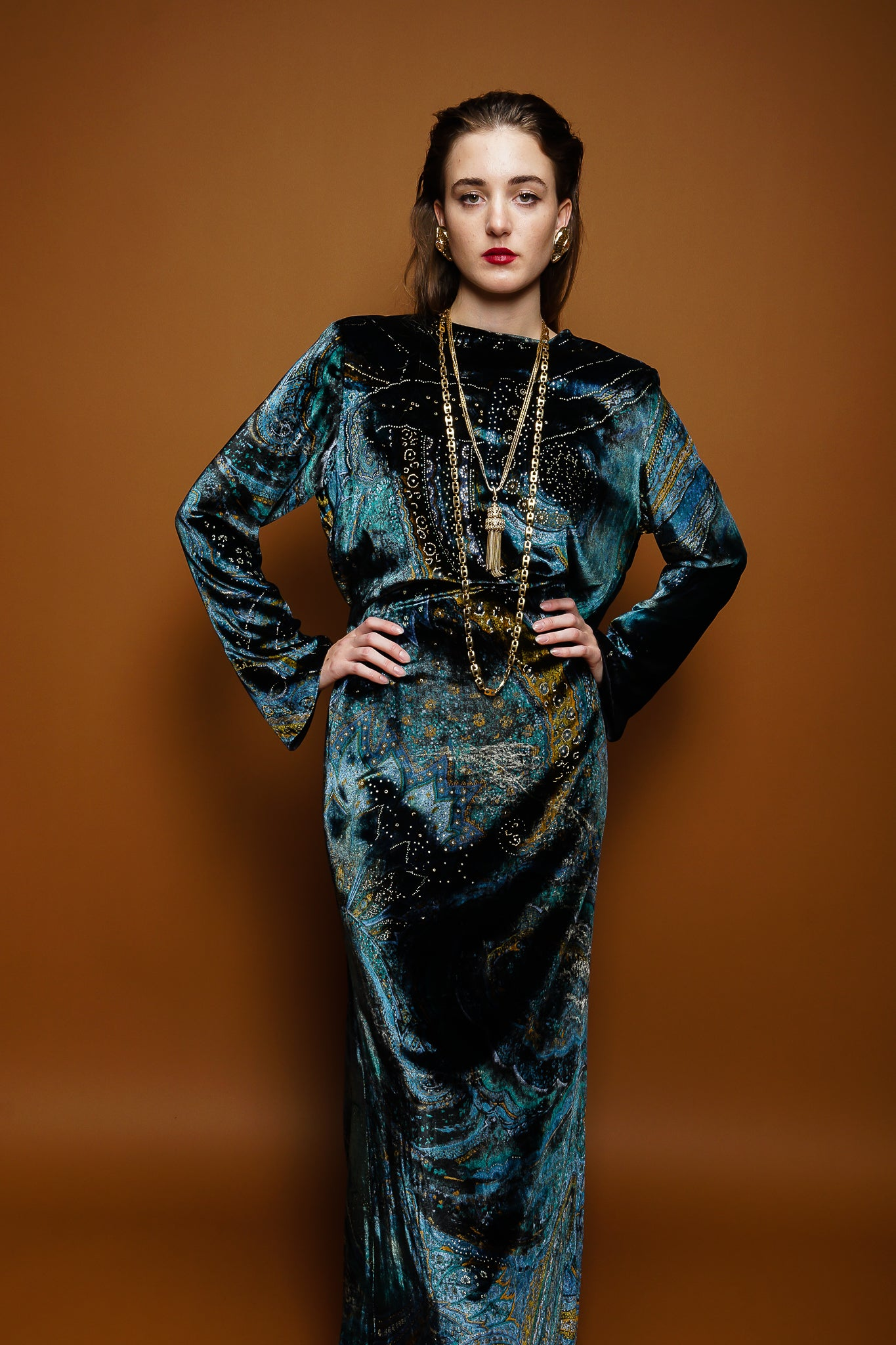 girl in YSL Saint Laurent velvet paisley galaxy gown & necklaces on brown @ Recess Los Angeles