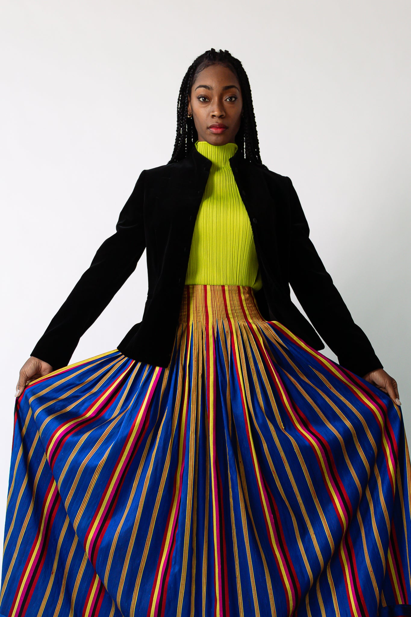 Girl in Peter Lai striped silk skirt and lime green turtleneck at Recess Los Angeles