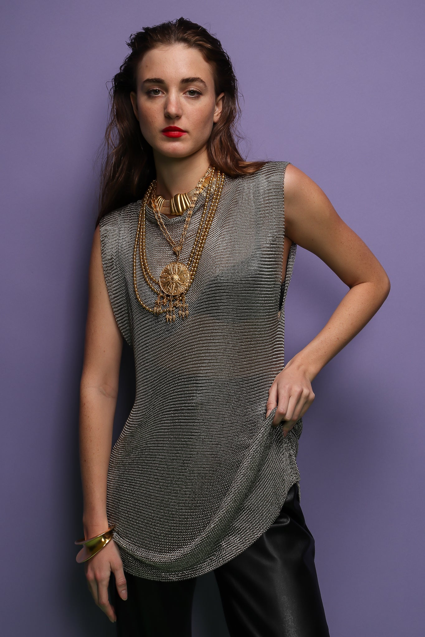 girl in silver metal mesh mini dress tunic and gold necklaces at Recess Los Angeles