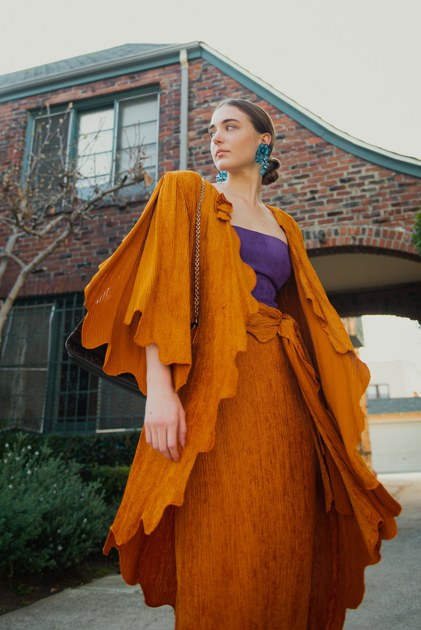 Girl in orange Vintage Holly's Harp Jacket and Skirt Set from Recess Los Angeles