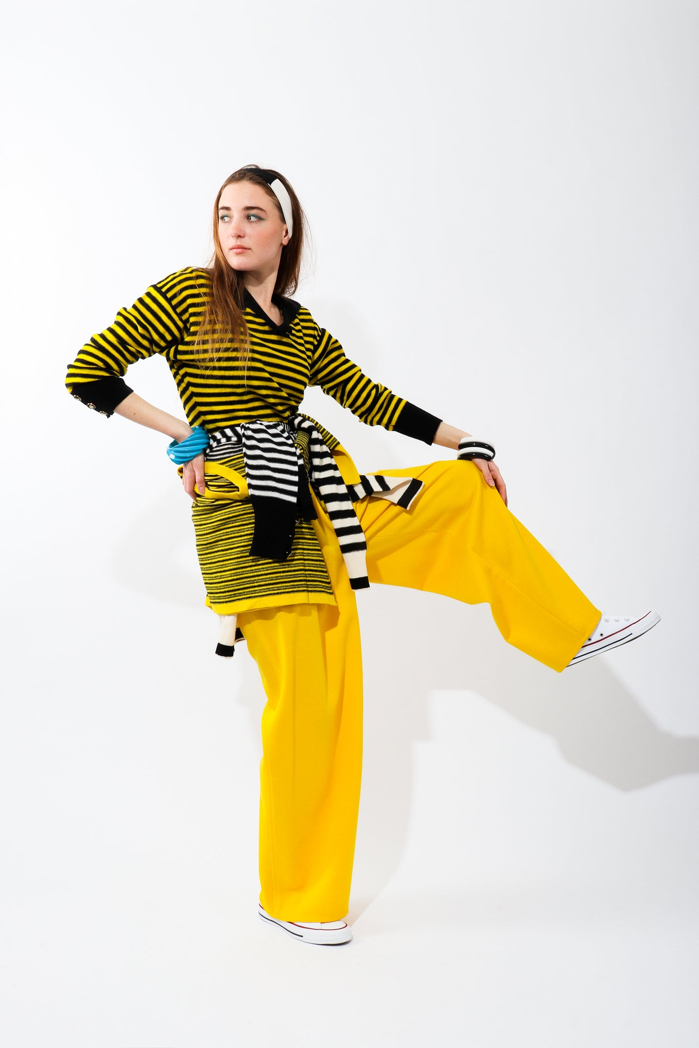 Recess Vintage Sonia Rykiel Rainbow Girl in yellow striped sweater and yellow pants on one leg