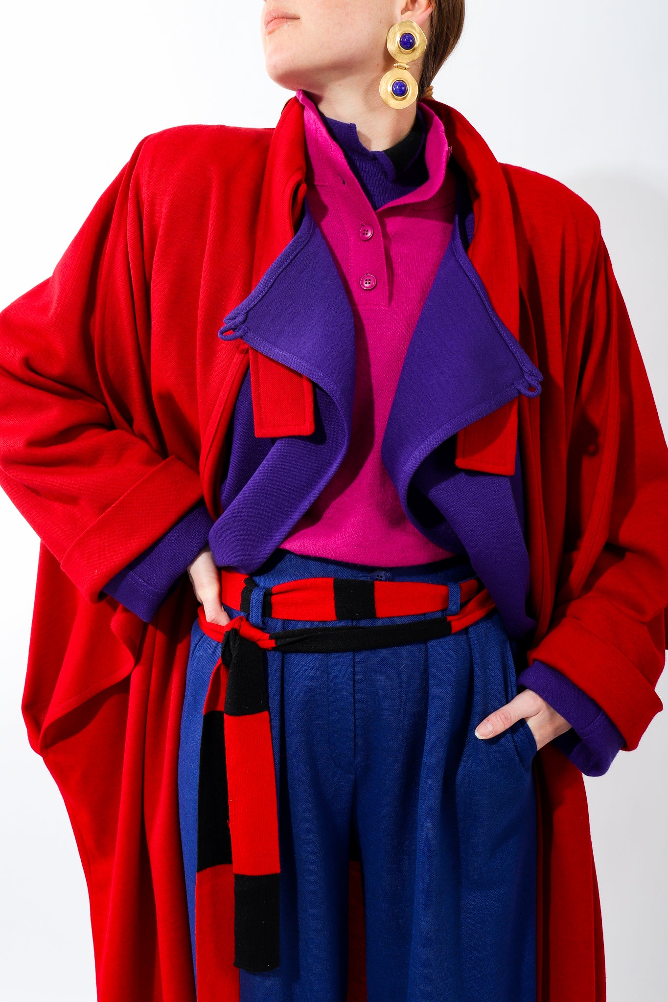 Girl in layers of purple red and pink Sonia Rykiel knit wool coats