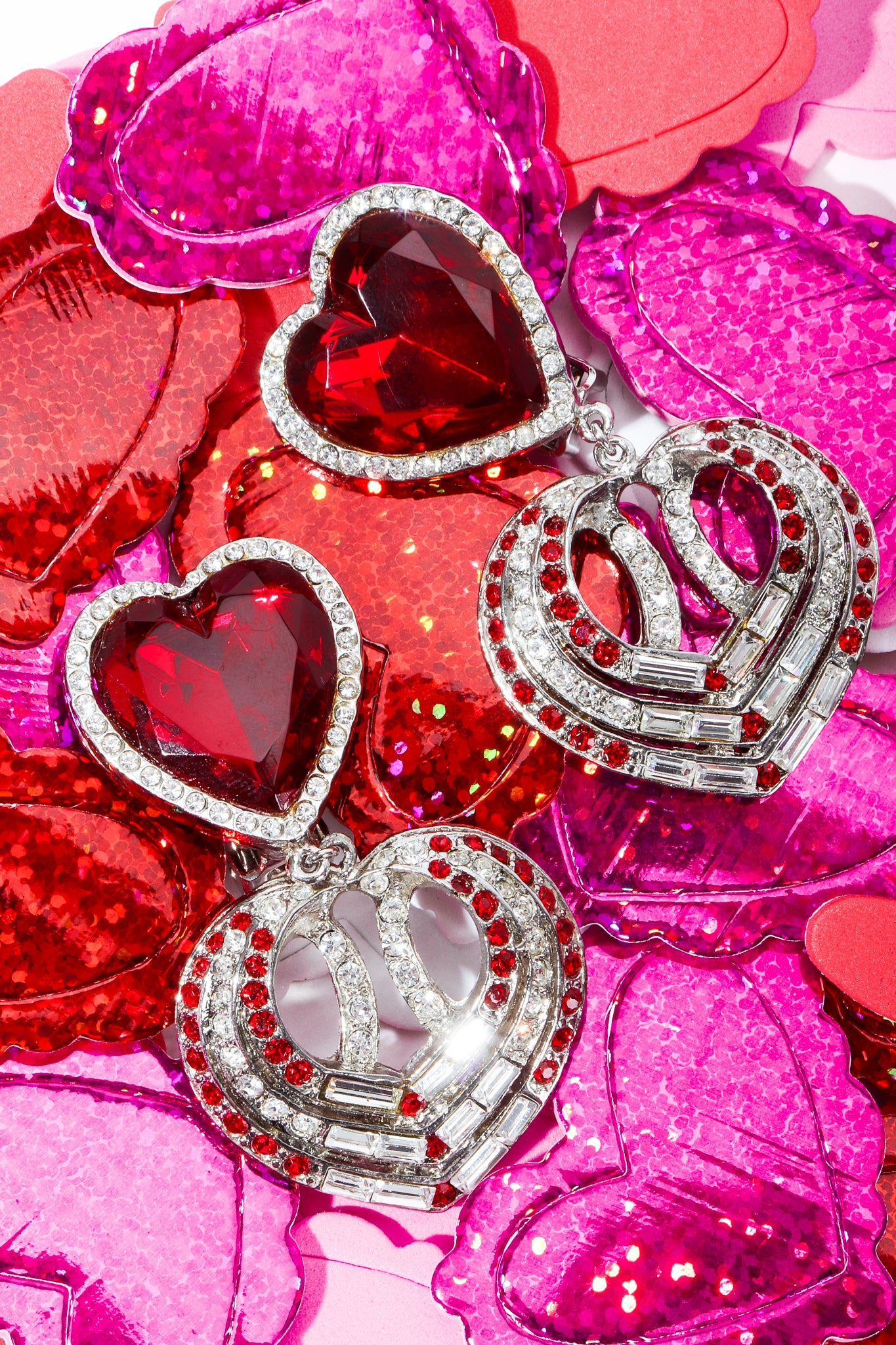 Red Faux Ruby Rhinestone Heart Earrings on holographic glitter heart shapes