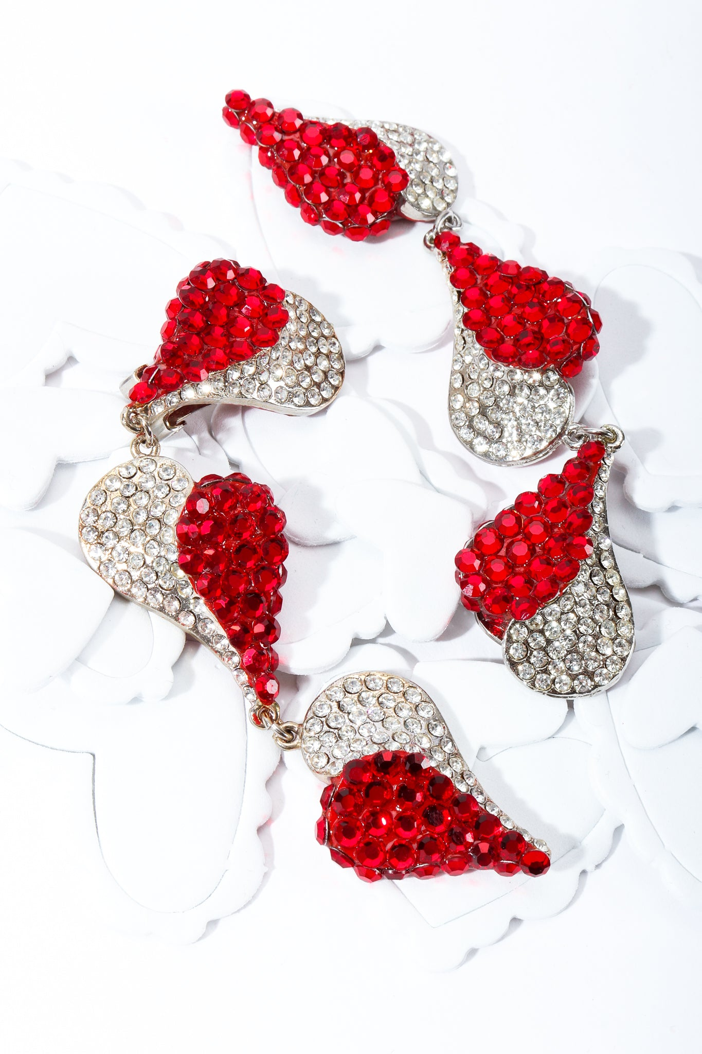 Red and Crystal rhinestone Falling Heart earrings on white heart shapes at Recess Los Angeles