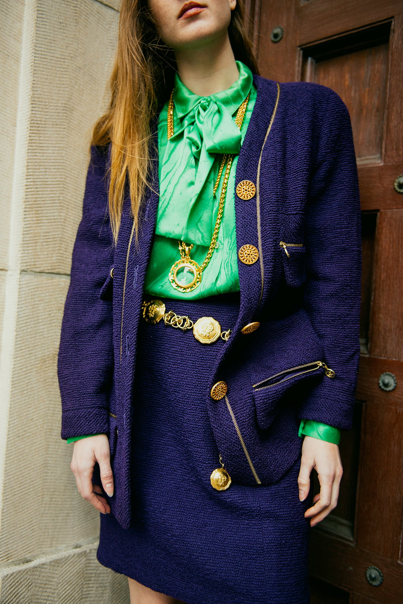 Recess girl in Vintage Chanel purple Boucle jacket and skirt with green blouse