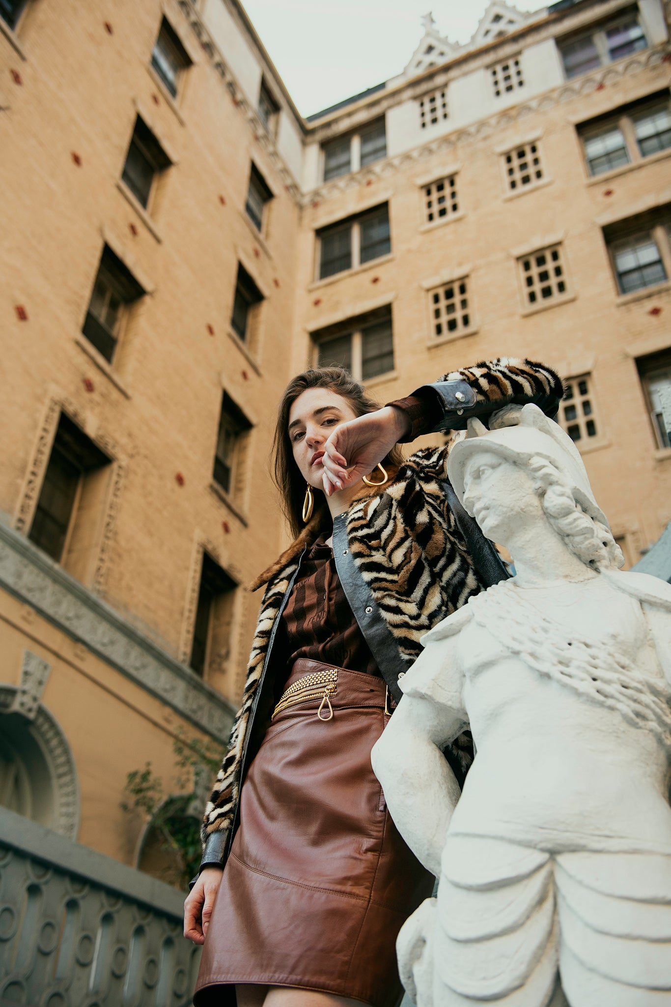 Recess Girl in Vintage Zoo Furs Mink Chevron Coat and Ferre Leather Skirt with statue