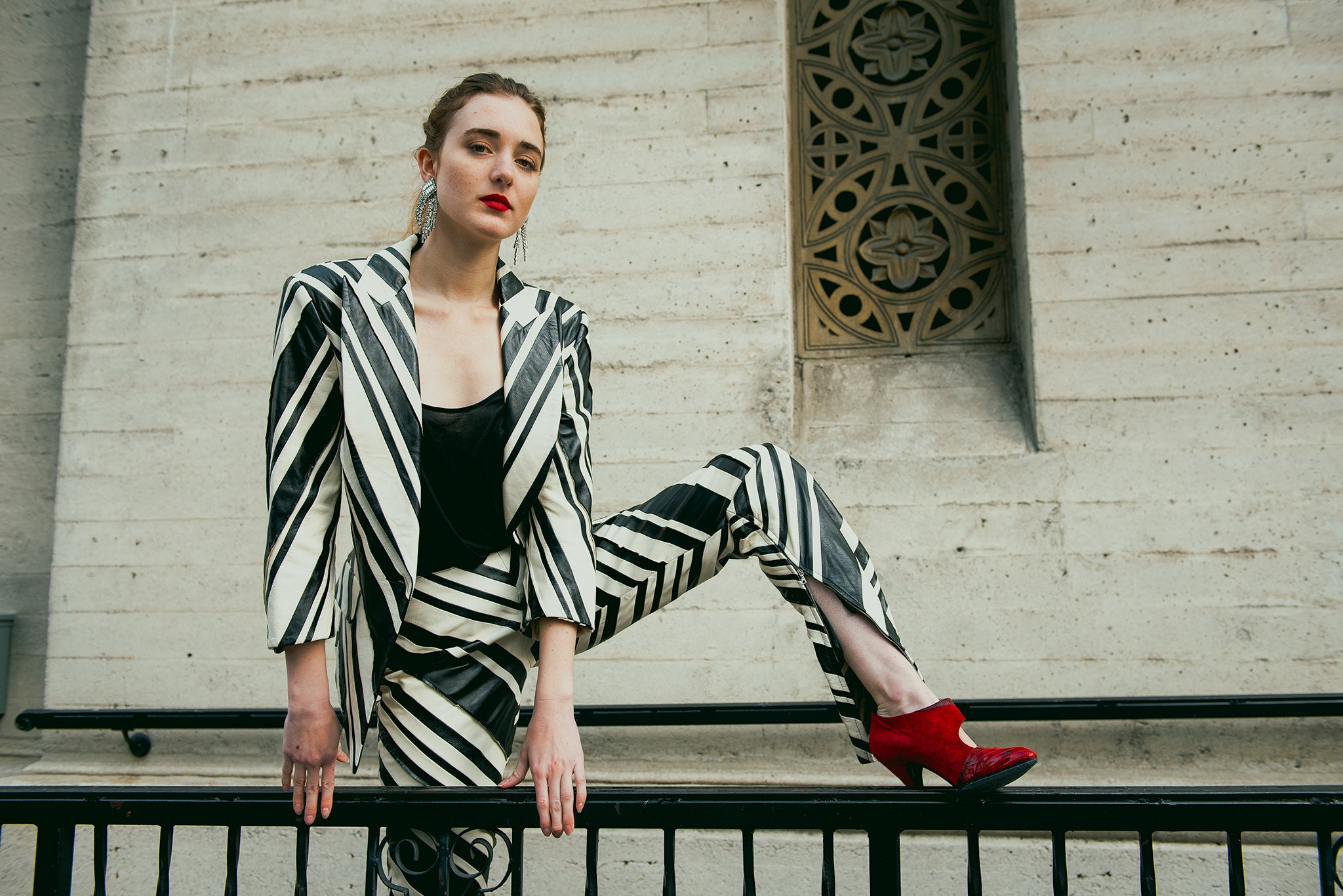 Recess Vintage Girl in Zebra striped Gianfranco Ferre Leather Suit climbing fence