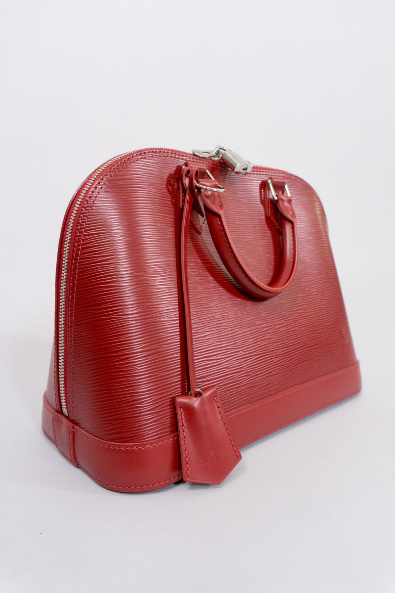 Louis Vuitton Epi Alma NM Handbag in Rubis Red