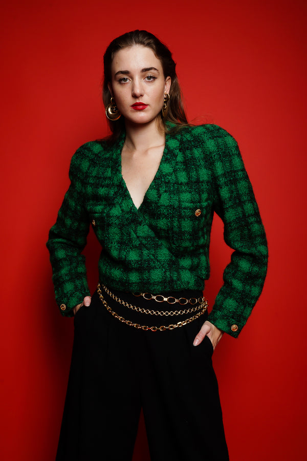 girl in Vintage Chanel Bouclé Plaid Tweed Wrap Jacket & chain belt on red at Recess Los Angeles