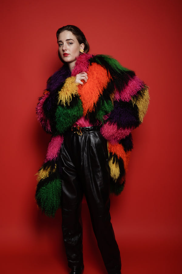 Girl in Vintage Neiman Marcus Rainbow Mosaic Mongolian Fur Coat on red background @ Recess LA