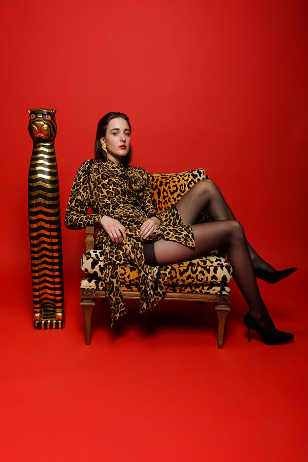 Girl in Vintage Yves Saint Laurent YSL Leopard Scarf Dress on red backdrop @ Recess Los Angeles