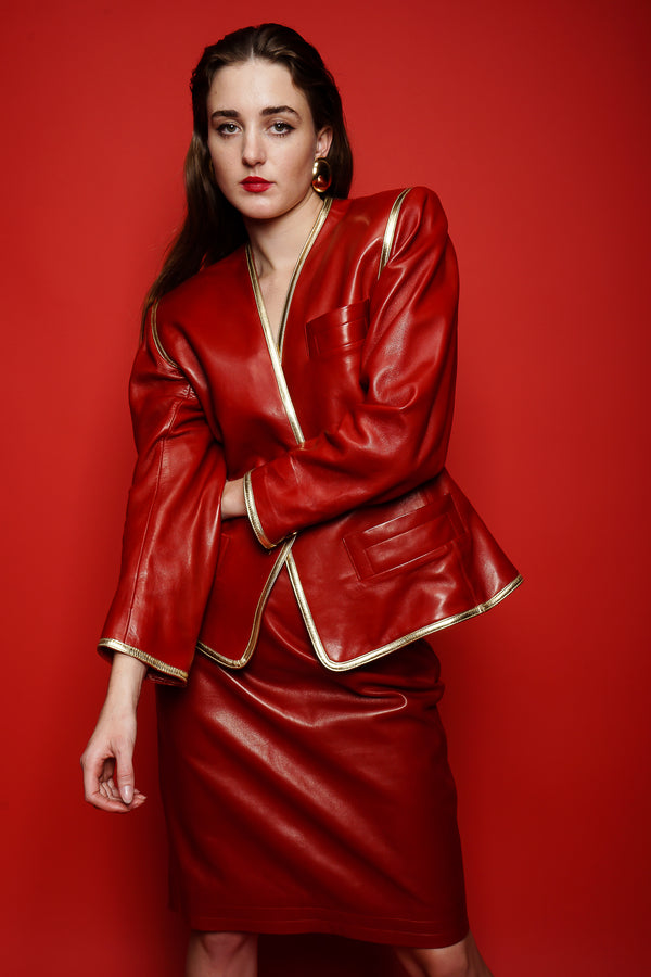 girl in Vintage YSL Yves Saint Laurent 1988 Red Leather Skirt Suit on red paper at Recess LA