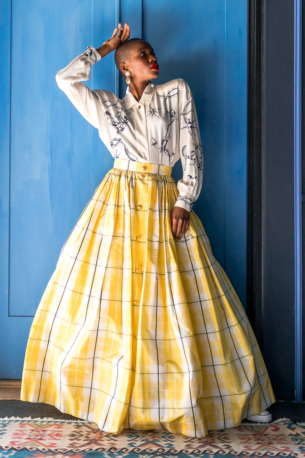 Monica Ahanonu in Vintage Escada Plaid Taffeta Ball Skirt with blue door at Recess Los Angeles