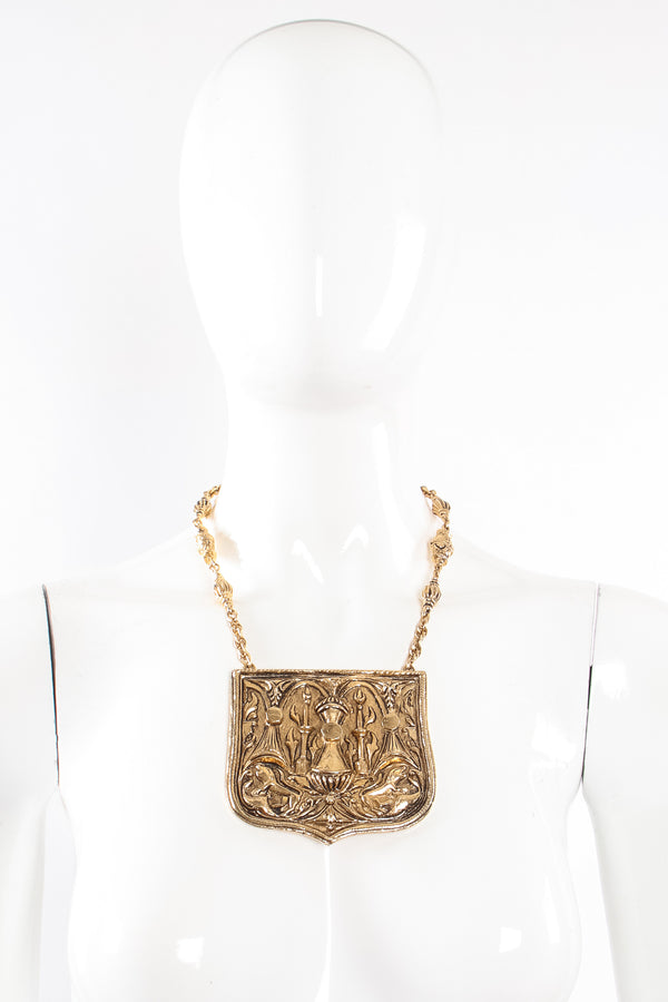 Vintage Accessocraft Brass Gothic Relief Plate Necklace on mannequin at Recess Los Angeles