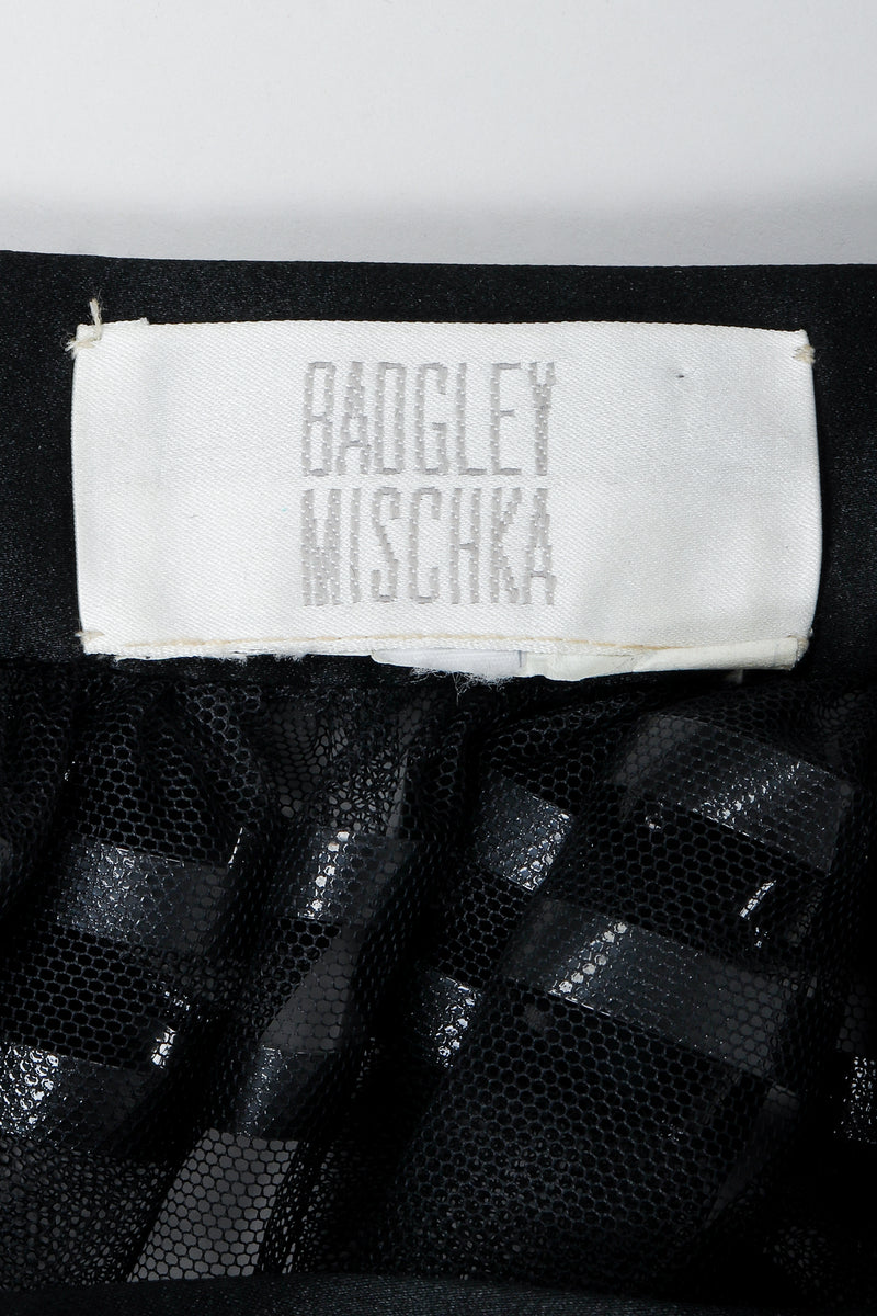 Vintage Badgley Mischka label on black fabric