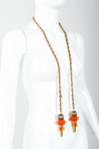 Vintage Unsigned Fiery Orange Beaded Tassel Wrap Necklace on Mannequin at Recess
