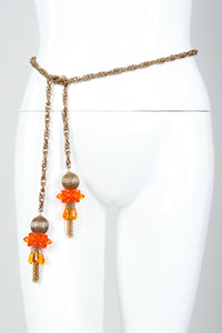 Vintage Unsigned Fiery Orange Beaded Tassel Wrap Necklace Belt on Mannequin waist at Recess