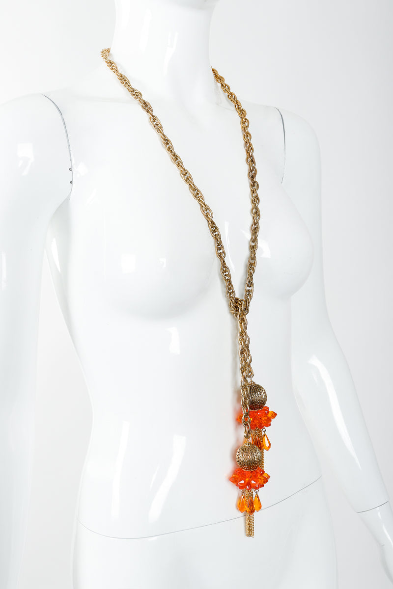 Vintage Unsigned Fiery Orange Beaded Tassel Wrap Necklace on Mannequin, wrapped at Recess