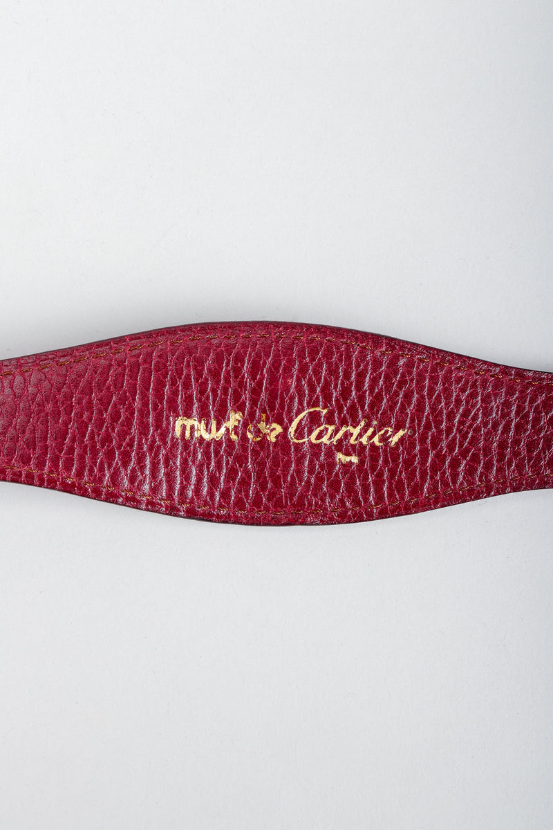 Vintage Cartier Gold Signature stamp on oxblood leather