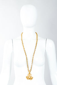 Vintage Chanel Gold Long Triple CC Logo Pendant Necklace swirled on mannequin
