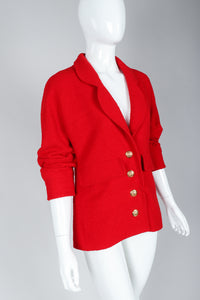 Recess Vintage Chanel Red Curved Lapel Bouclé Jacket on Mannequin, Sleeves Pushed Up