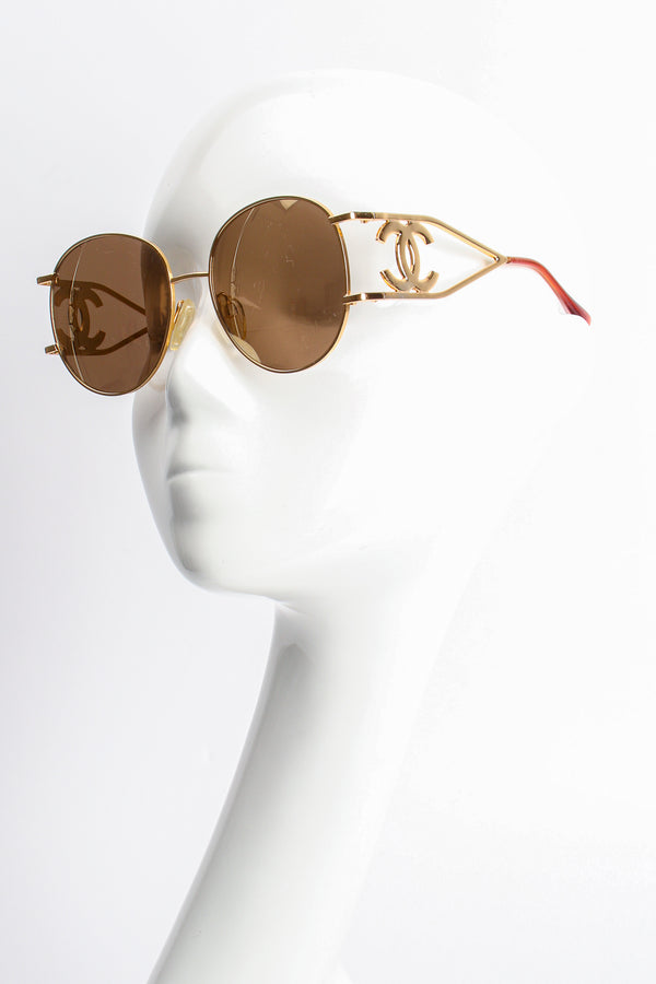 Vintage Chanel 1990s CC Gold Mirror Miller Sunglasses on mannequin at Recess Los Angeles