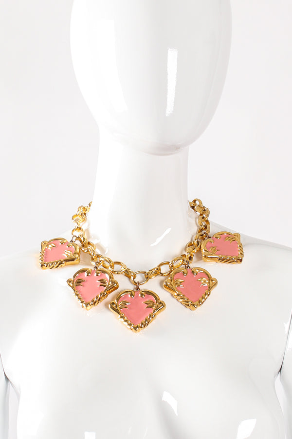 Vintage Escada Pink Enamel Hearts Charm Necklace on mannequin at Recess Los Angeles