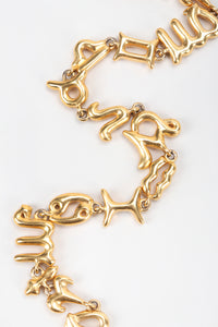 Recess Vintage Fendi Gold Astrology Symbol Collar Necklace on White Background