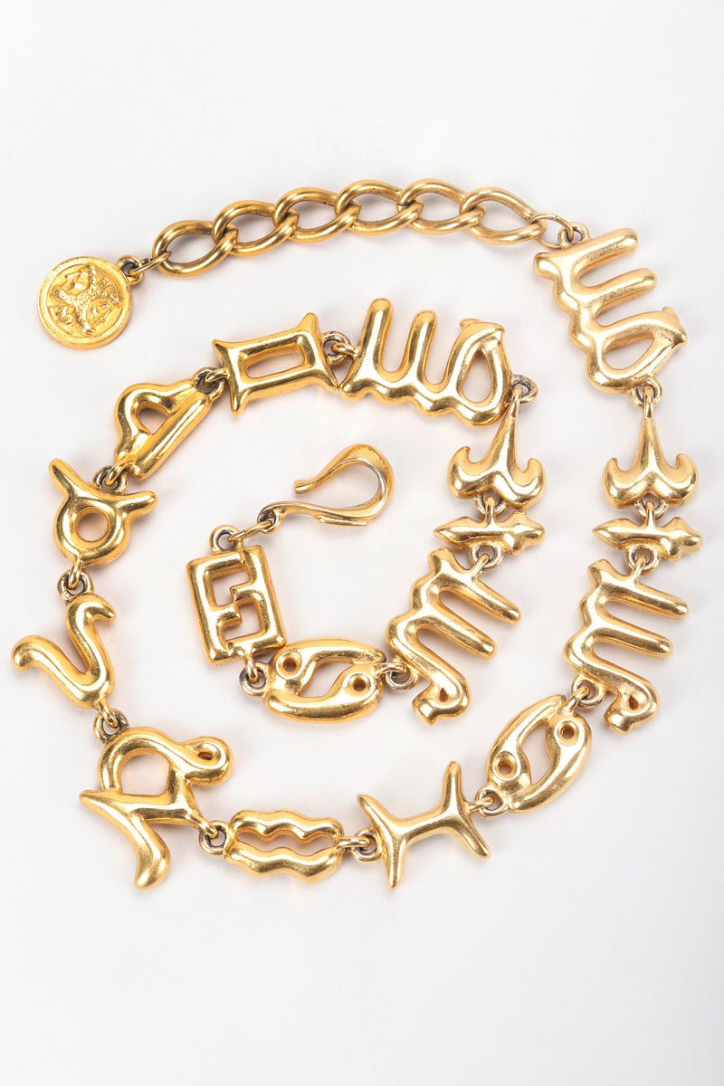 Recess Vintage Fendi Gold Astrology Symbol Collar Necklace coiled on White Background