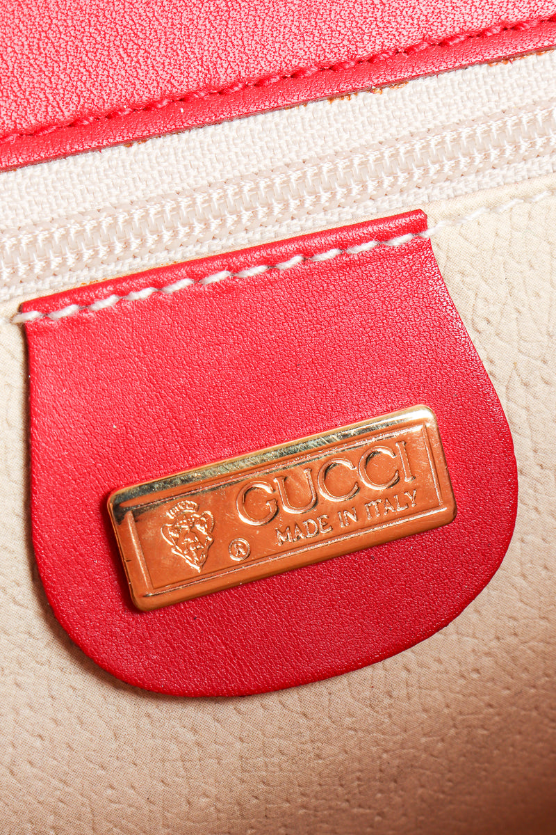 Vintage Gucci Red Flora Convertible Clutch metal signature tag at Recess Los Angeles