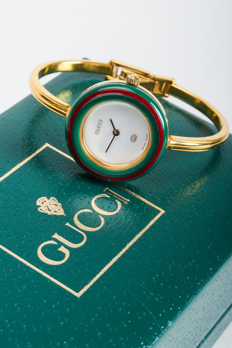 Vintage Gucci 1952 Boxed Bracelet Watch on top of green Gucci box