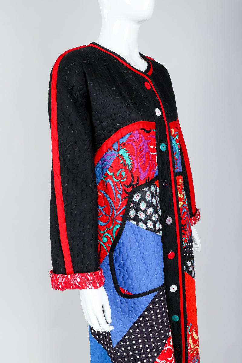 Recess Vintage Jeanne Marc Multicolor Quilted Patchwork Duster Coat on Mannequin, close up