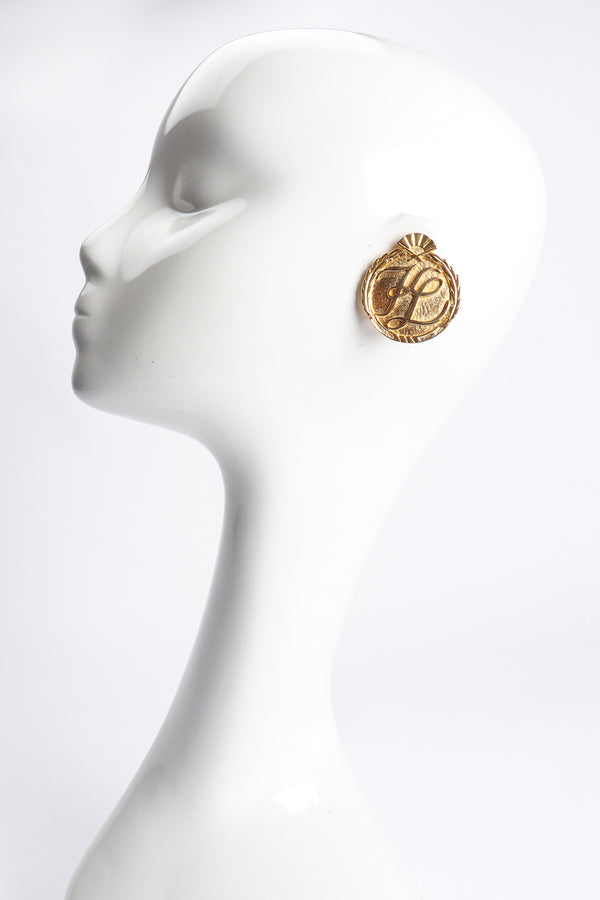 Vintage Karl Lagerfeld Gold Monogram Logo Button Earrings on Mannequin at Recess Los Angeles
