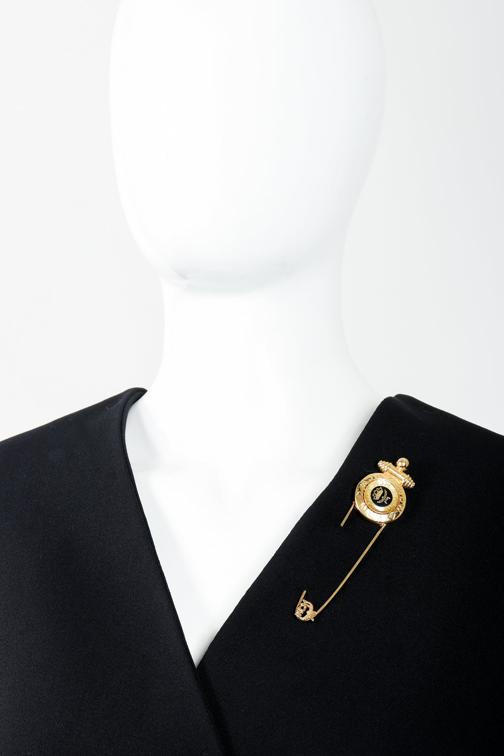 Vintage MCM Gold Logo Safety Pin Brooch on Mannequin at Recess Los Angeles