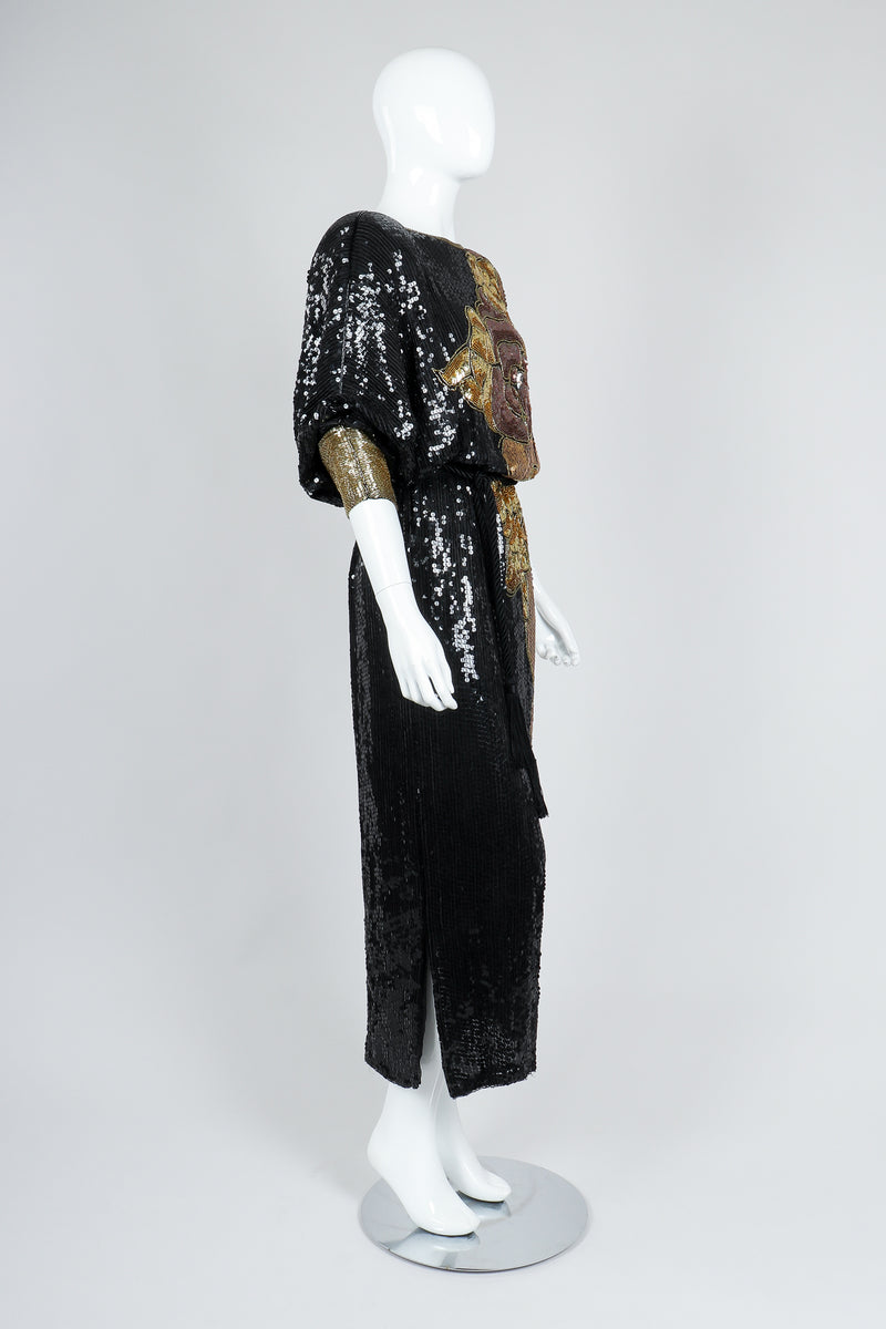 Recess Vintage Black Gold Asymmetrical Sequin Batwing Dress on Mannequin, angled