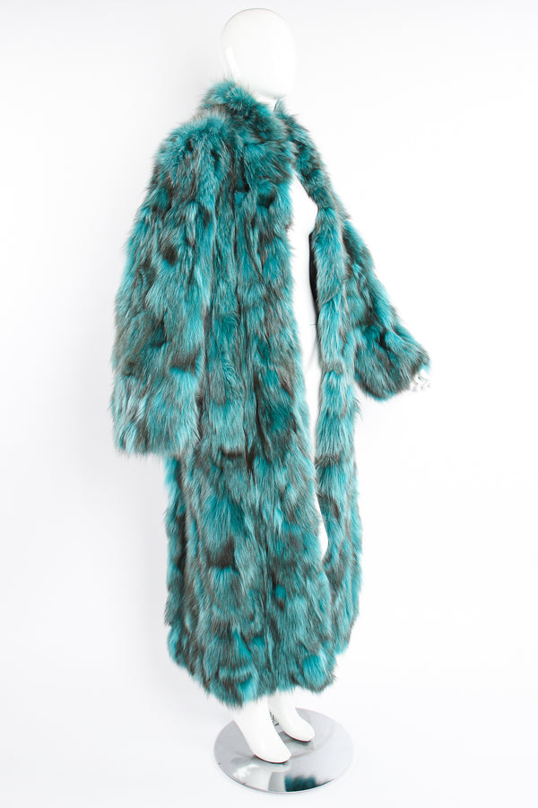 Vintage Made In Greece Teal Long Fox Fur Coat on Mannequin side at Recess Los Angeles