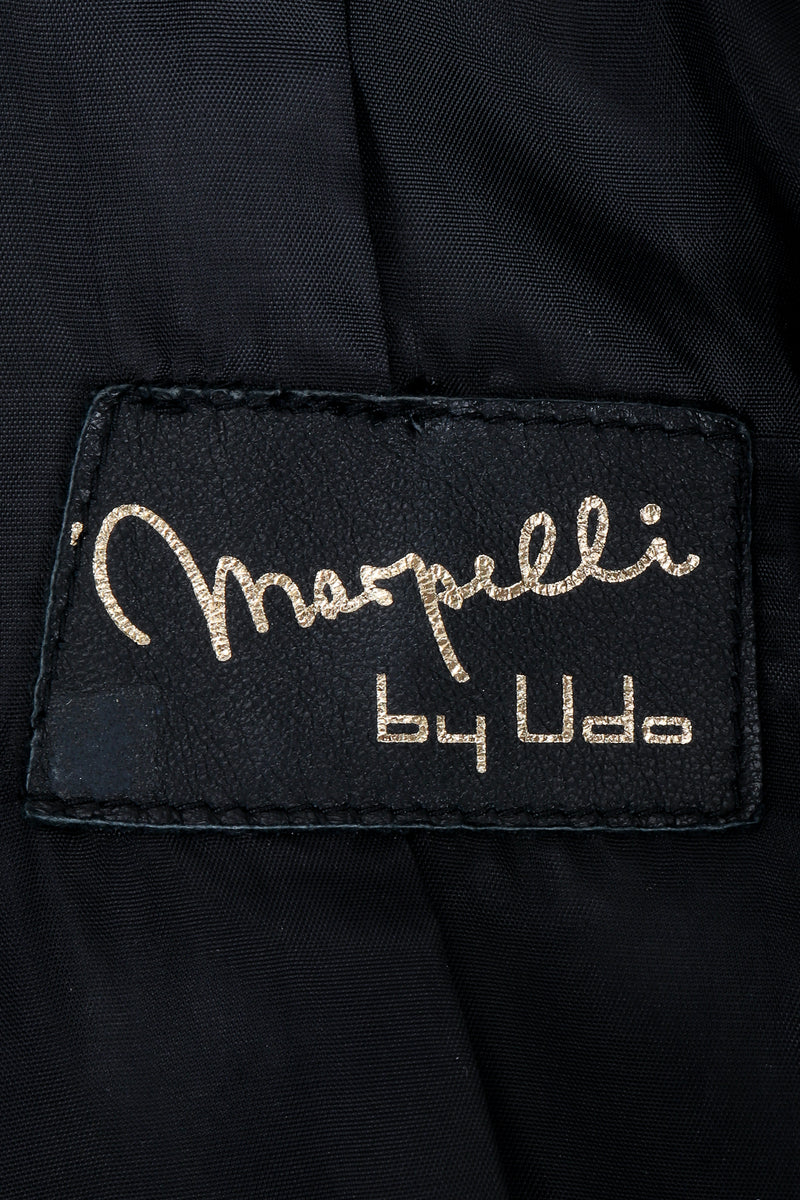 Vintage Marpelli by Udo label on black fabric