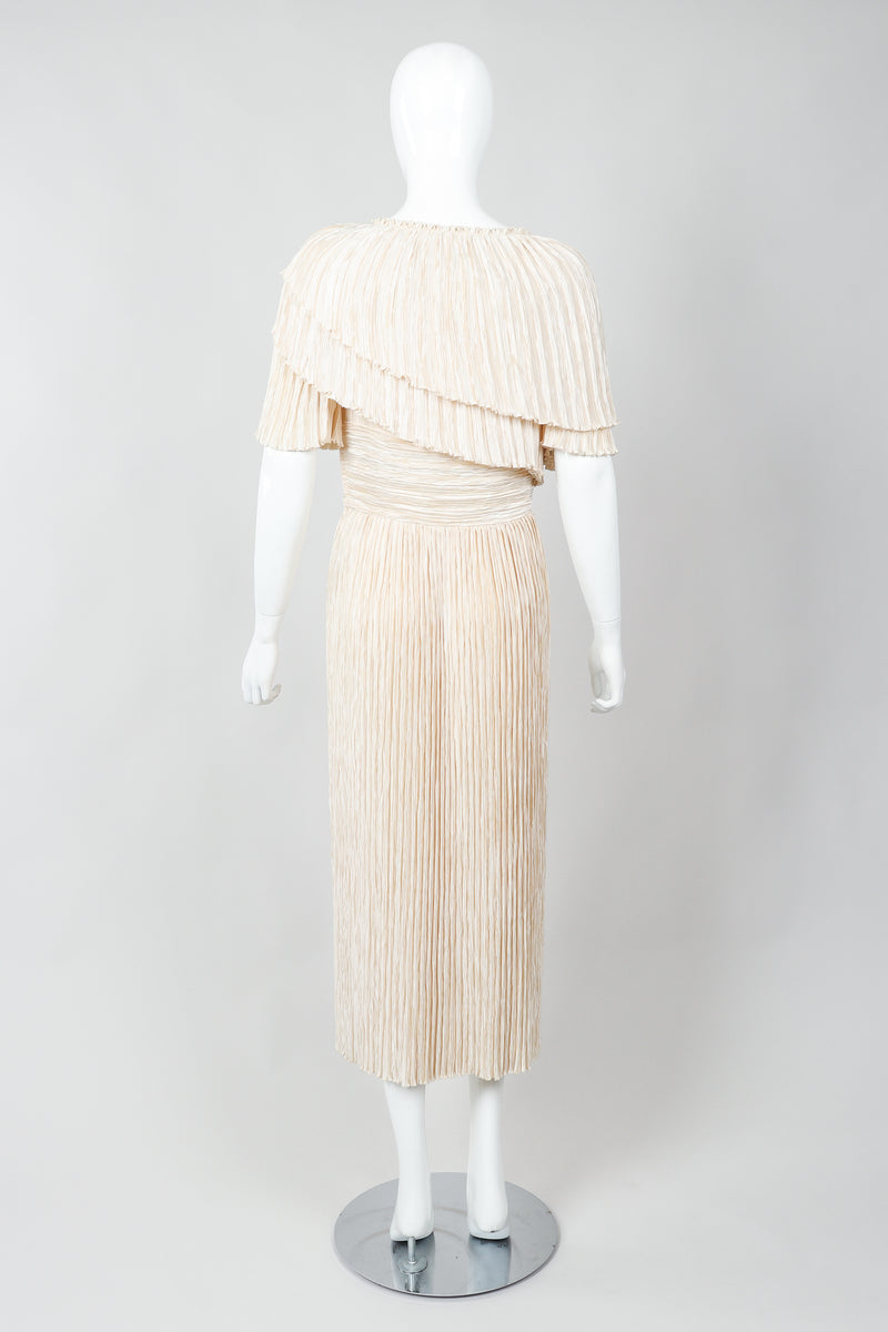Vintage Mary McFadden Cream Pleated Asymmetrical Draped Collar Dress on Mannequin back at Recess