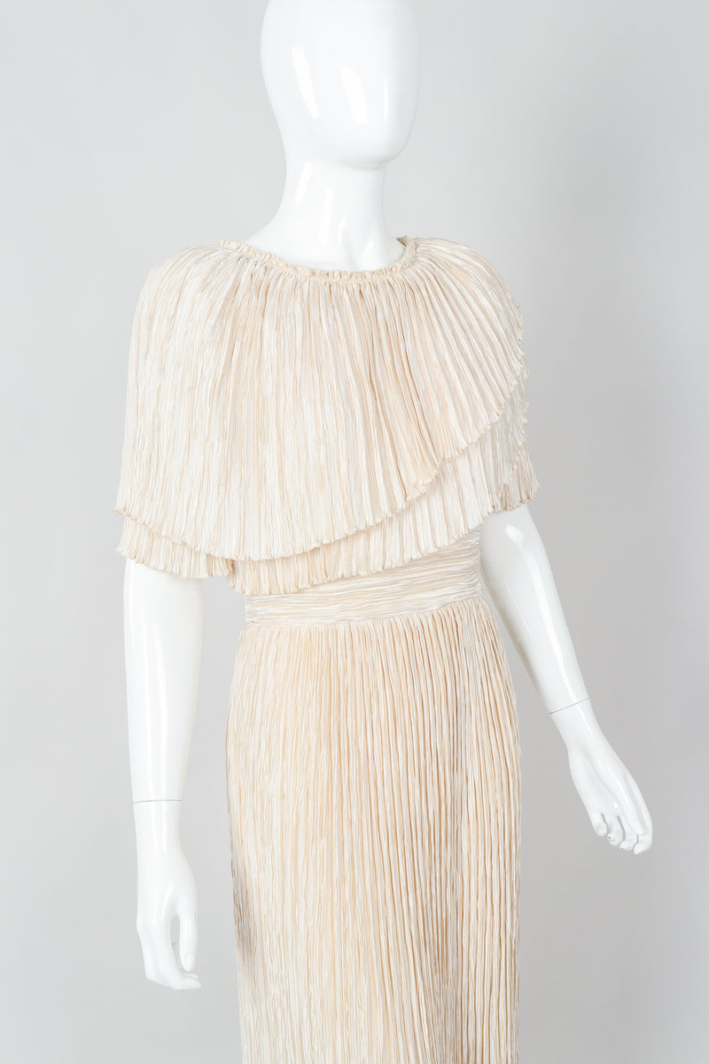 Vintage Mary McFadden Cream Pleated Asymmetrical Draped Collar Dress on Mannequin crop at Recess