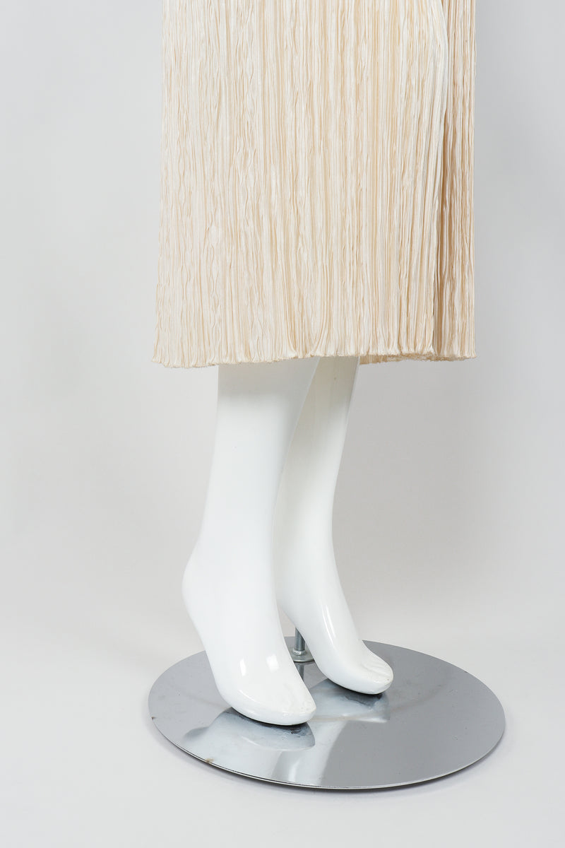 Vintage Mary McFadden Cream Pleated Asymmetrical Draped Collar Dress on Mannequin Skirt Hem