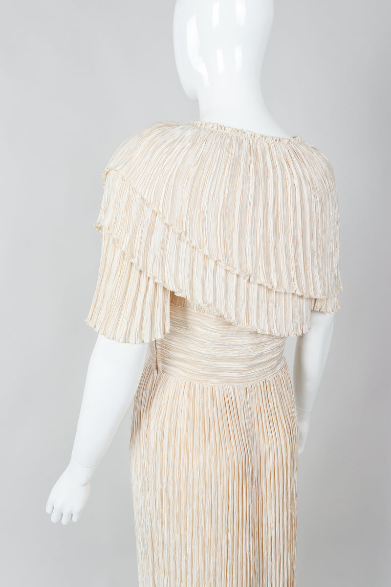 Vintage Mary McFadden Cream Pleated Asymmetrical Draped Collar Dress on Mannequin angled at Recess
