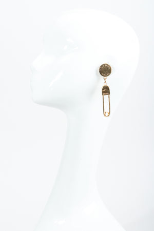 Vintage Moschino I Believe In Punk Chic Safety Pin Earrings on Mannequin at Recess