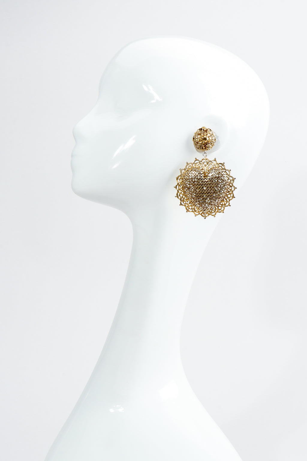Vintage Perforated Sunburst Heart Drop Earrings on Mannequin at Recess Los Angeles