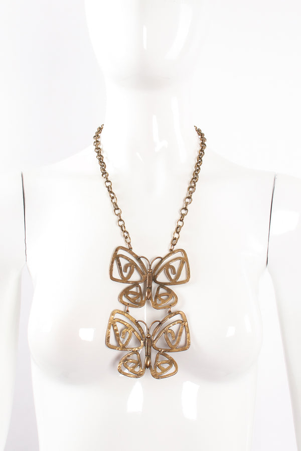 Vintage Brass Double Butterfly Necklace on mannequin at Recess Los Angeles