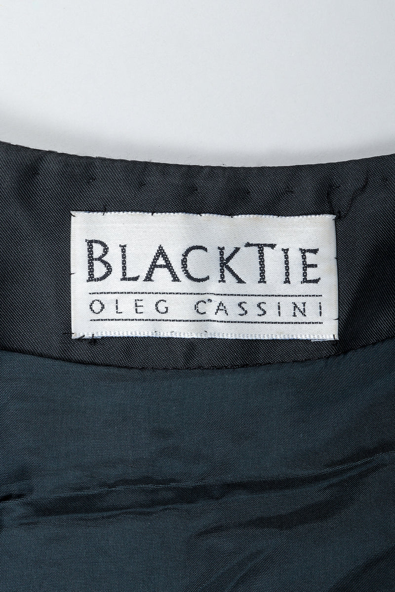 Vintage Oleg Cassini Black Tie Label on black fabric