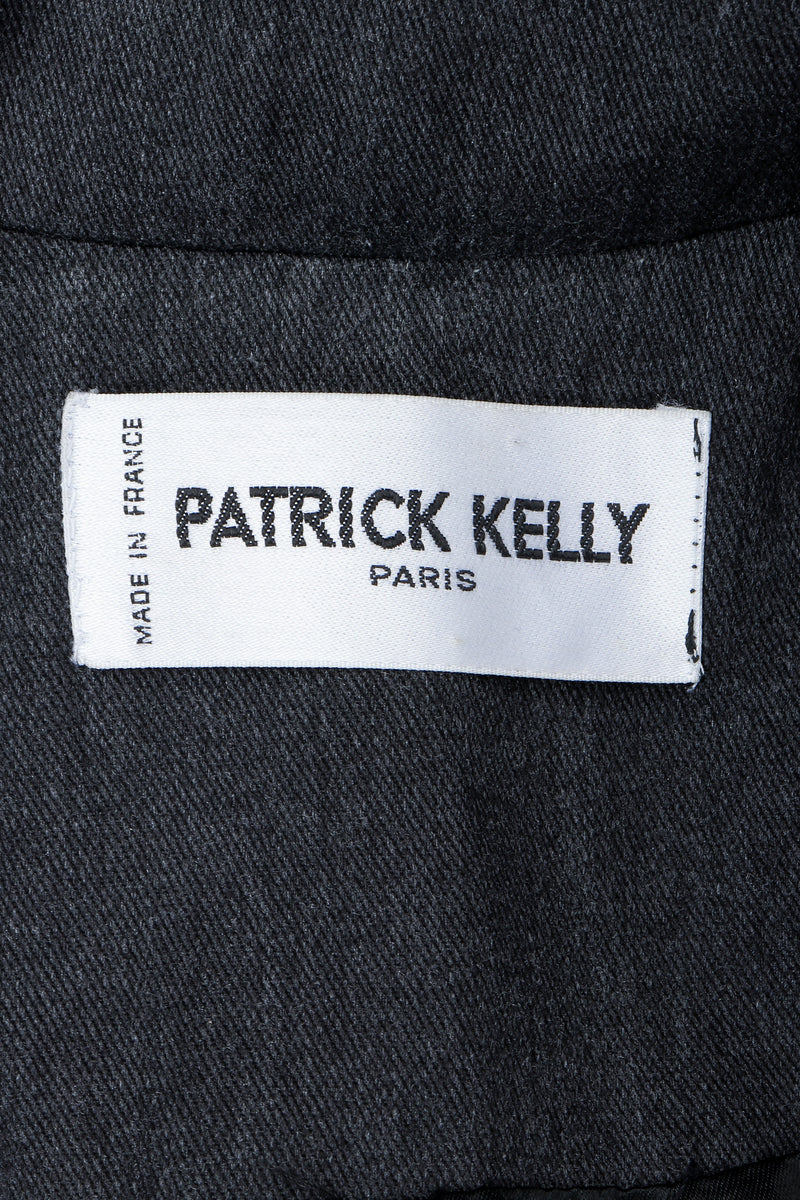 Vintage Patrick Kelly Label on black fabric