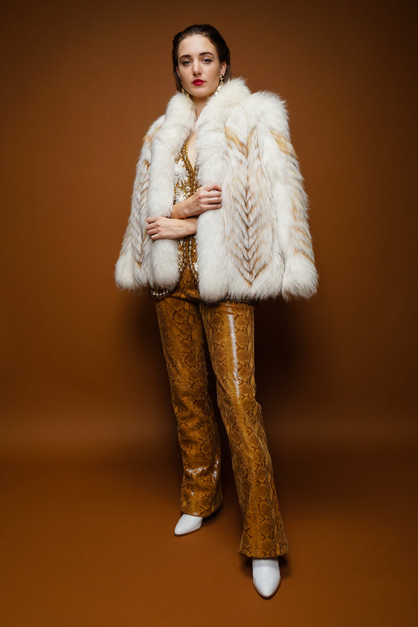 girl in Vintage Braude Snakeskin Bootcut Pant and fox fur on brown at Recess Los Angeles
