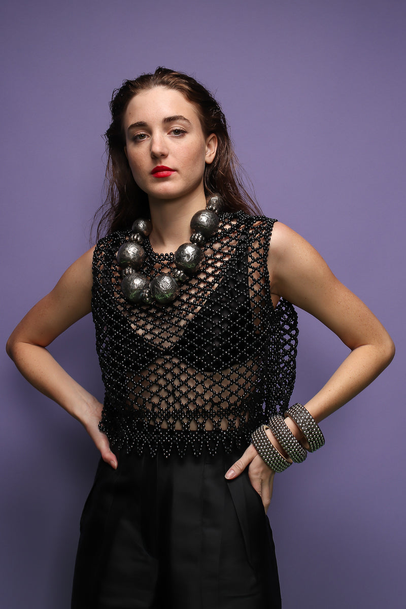 girl in black bead top and Vintage India Hammered Ball Collar Necklace on purple at Recess LA
