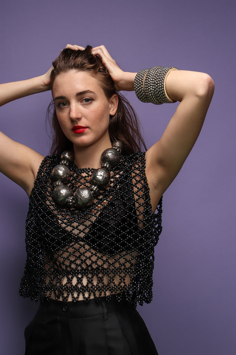 girl in Vintage 60s Bead Mesh Boxy Top & bra on purple background at Recess Los Angeles